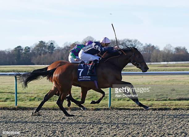 Thomas Brown riding Sayem win The 32Red casino EBF Maiden Fillies' Stakes at Lingfield Park on December14 2016 in Lingfield England