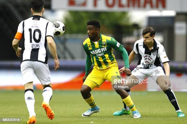 Thomas Bruns of Heracles Almelo Guyon Fernandez of ADO Den Haag Justin Hoogma of Heracles Almeloduring the Dutch Eredivisie match between Heracles...