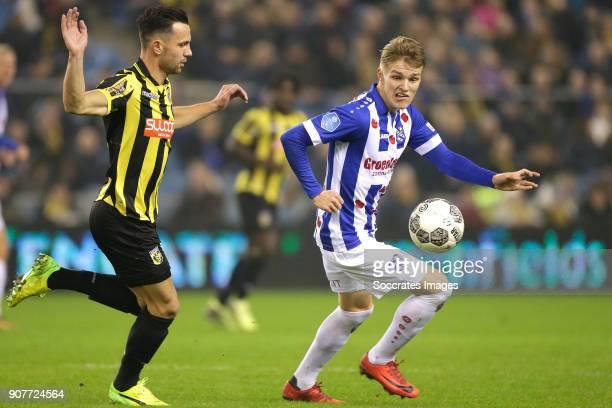 Thomas Bruns of Vitesse Martin Odegaard of SC Heerenveen during the Dutch Eredivisie match between Vitesse v SC Heerenveen at the GelreDome on...