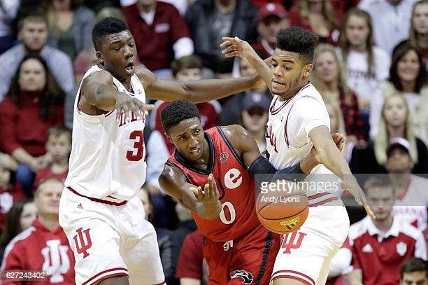 Thomas Bryant and Juwan Morgan of the Indiana Hoosiers defend Carlos Anderson of the SIU Edwardsville Cougars at Assembly Hall on December 2 2016 in...