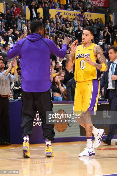 Thomas Bryant and Kyle Kuzma of the Los Angeles Lakers exchange high fives during the game against the Denver Nuggets on March 13 2018 at STAPLES...