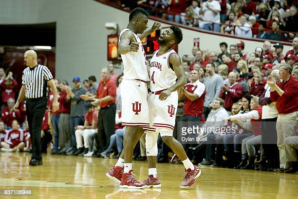 Thomas Bryant and Robert Johnson of the Indiana Hoosiers celebrate in the second half against the Nebraska Cornhuskers at Assembly Hall on December...