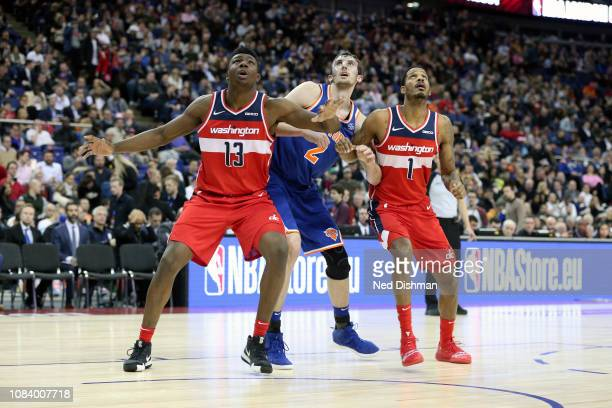 Thomas Bryant and Trevor Ariza of the Washington Wizards box out Luke Kornet of the New York Knicks during the 2019 NBA London Game on January 17...