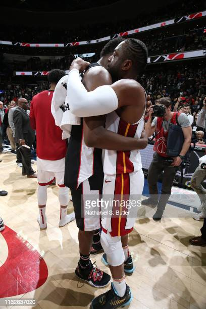 Thomas Bryant of the Washington Wizards and Dwyane Wade of the Miami Heat hug after the game against the Washington Wizards on March 23 2019 at...