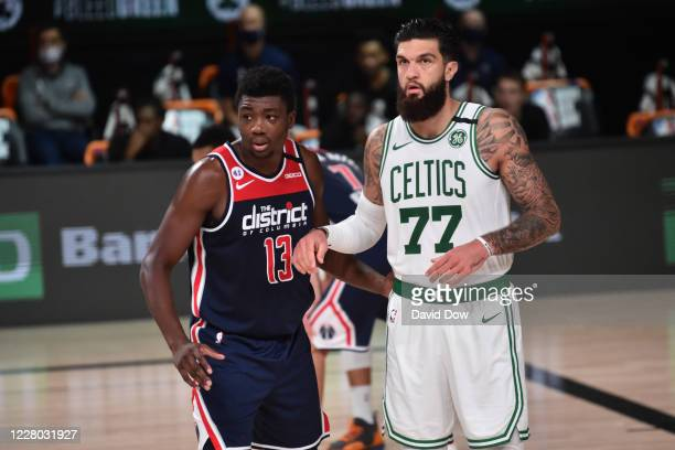 Thomas Bryant of the Washington Wizards and Vincent Poirier of the Boston Celtics look on during the game on August 13, 2020 at AdventHealth Arena in...