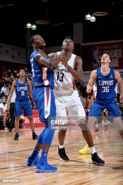 Thomas Bryant of the Washington Wizards battles for position against Angel Delgado of the LA Clippers during the 2018 Las Vegas Summer League on July...