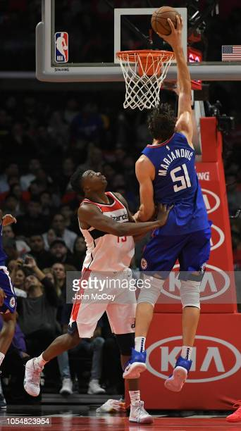 Thomas Bryant of the Washington Wizards can not stop Boban Marjanovic of the Los Angeles Clippers from dunking the ball in the second half at Staples...