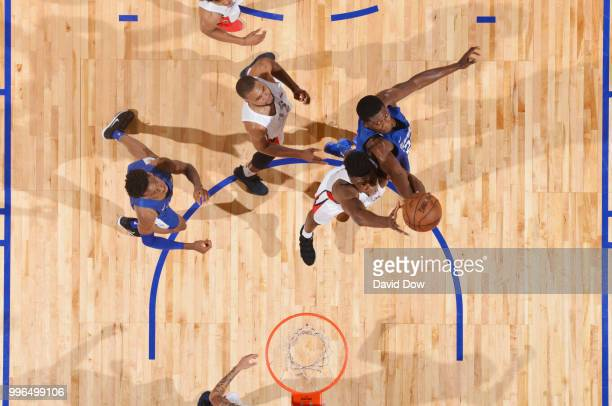 Thomas Bryant of the Washington Wizards goes up for a rebound against Angel Delgado of the LA Clippers during the 2018 Las Vegas Summer League on...