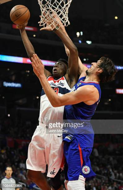 Thomas Bryant of the Washington Wizards shoots the ball over Boban Marjanovic of the Los Angeles Clippers in the second half at Staples Center on...