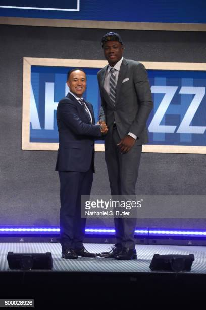 Thomas Bryant shakes hands with Deputy Commissioner Mark Tatum after being selected number forty second overall by the Utah Jazz during the 2017 NBA...