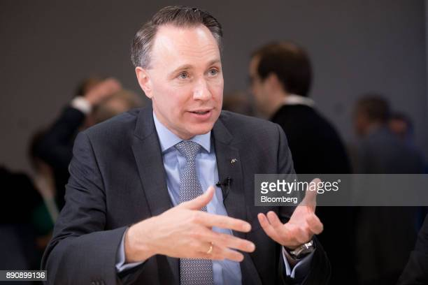 Thomas Buberl chief executive officer of AXA SA gestures while speaking during a Bloomberg Television interview at the One Planet Summit in Paris...