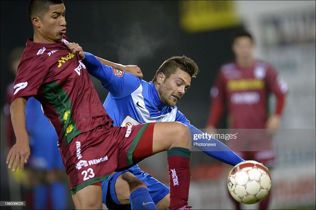 Thomas Buffel of KRC Genk battles for the ball with Hernan Hinostroza of Zulte-Waregem during the Cofidis Cup 1/4 final away match between SV Zulte Waregem and KRC Genk in the Regenboog stadium on December 13, 2012 in Waregem, Belgium.