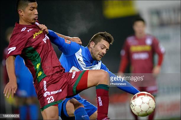 Thomas Buffel of KRC Genk battles for the ball with Hernan Hinostroza of Zulte-Waregem during the Cofidis Cup 1/4 final away match between SV Zulte...