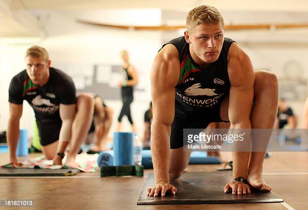 Thomas Burgess and George Burgess stretch during a South Sydney Rabbitohs NRL yoga session at Clovelly Beach on September 23 2013 in Sydney Australia