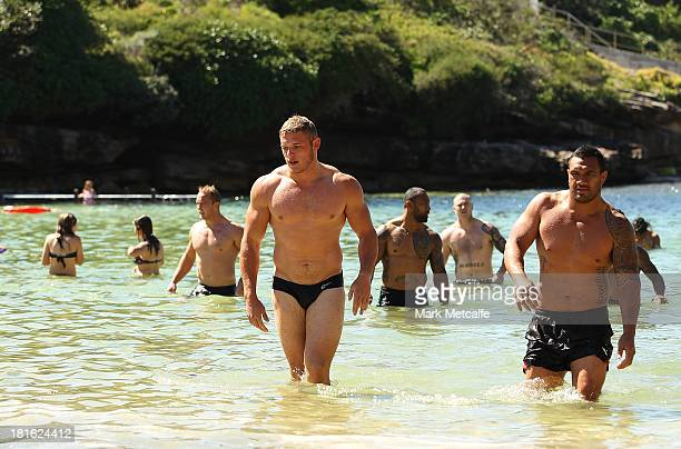 Thomas Burgess and team mates walk from the ocean during a South Sydney Rabbitohs NRL recovery session at Clovelly Beach on September 23 2013 in...