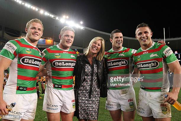 Thomas Burgess George Burgess Julie Burgess Luke Burgess and Sam Burgess pose after the round 25 NRL match between the Wests Tigers and the South...