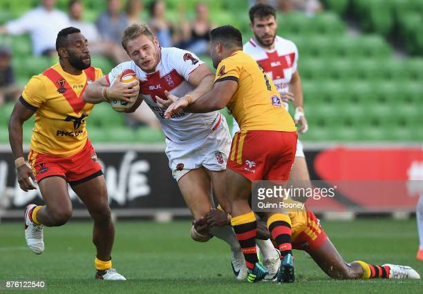 Thomas Burgess of England is tackled during the 2017 Rugby League World Cup Quarter Final match between England and Papua New Guinea Kumuls at AAMI...