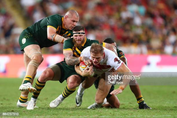 Thomas Burgess of England is tackled during the 2017 Rugby League World Cup Final between the Australian Kangaroos and England at Suncorp Stadium on...