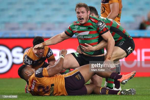 Thomas Burgess of the Rabbitohs celebrates after scoring a try during the round 13 NRL match between the South Sydney Rabbitohs and the Brisbane...