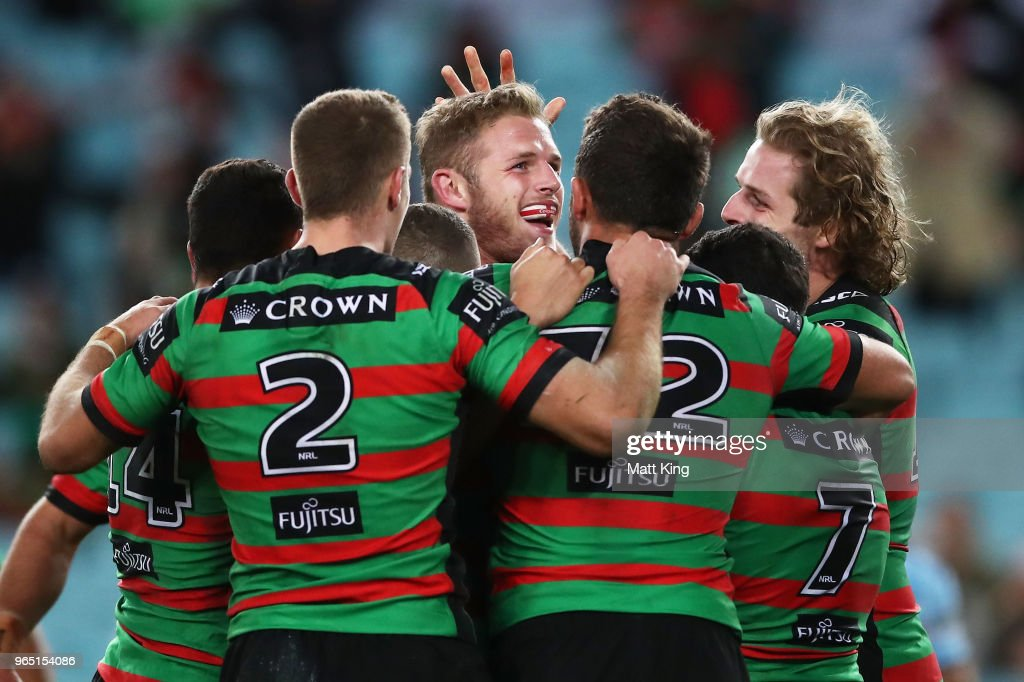 Thomas Burgess of the Rabbitohs celebrates with team mates after scoring a try during the round 13 NRL match between the South Sydney Rabbitohs and the Cronulla Sharks at ANZ Stadium on June 1, 2018 in Sydney, Australia.
