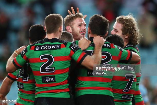 Thomas Burgess of the Rabbitohs celebrates with team mates after scoring a try during the round 13 NRL match between the South Sydney Rabbitohs and...