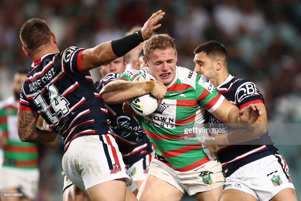 Thomas Burgess of the Rabbitohs is tackled by Roosters defence during the round six NRL match between the Sydney Roosters and the South Sydney Rabbitohs at Allianz Stadium on April 12, 2018 in Sydney, Australia.