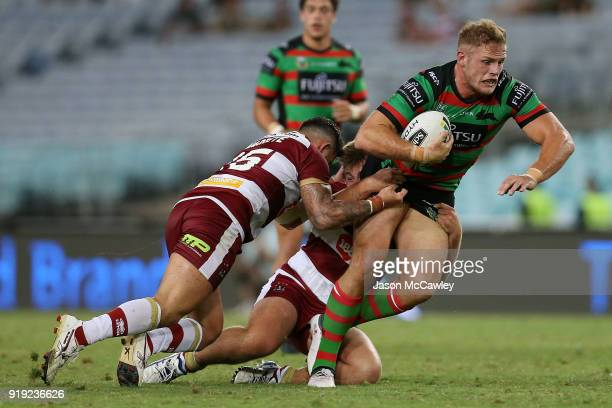 Thomas Burgess of the Rabbitohs is tackled during the NRL trial match between the South Sydney Rabbitohs and Wigan at ANZ Stadium on February 17 2018...