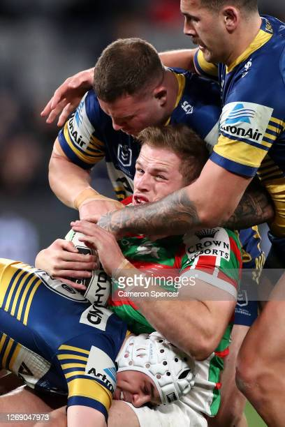 Thomas Burgess of the Rabbitohs is tackled during the round 16 NRL match between the Parramatta Eels and the South Sydney Rabbitohs at Bankwest...
