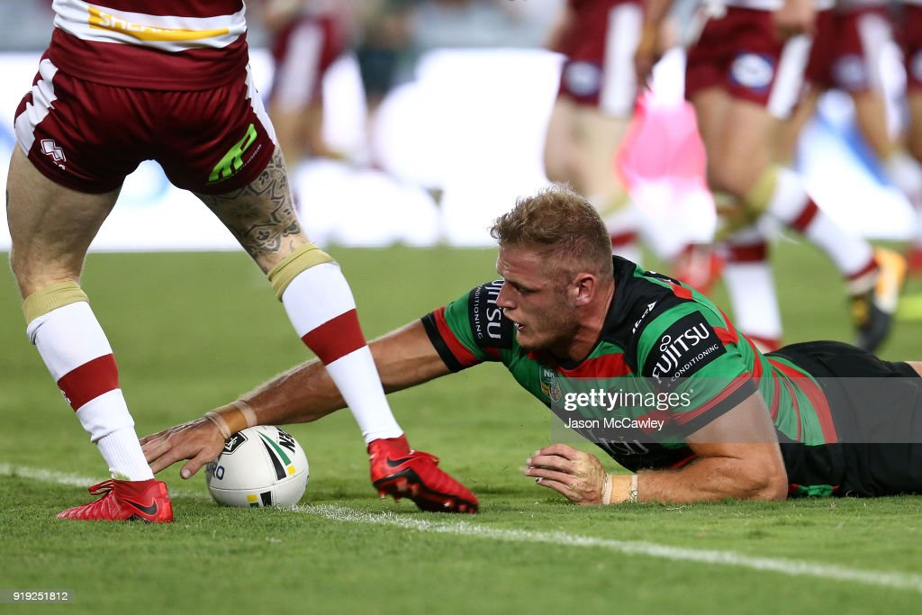 Thomas Burgess of the Rabbitohs scores a try during the NRL trial match between the South Sydney Rabbitohs and Wigan at ANZ Stadium on February 17, 2018 in Sydney, Australia.