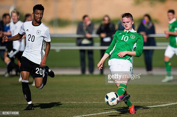 Thomas Byrne of Ireland plays the ball next to Timothy Tillman of Germany during the U18 international friendly match between Ireland and Germany on...