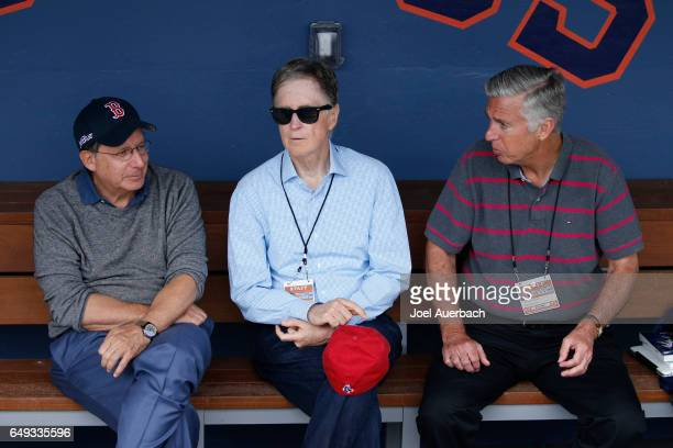 Thomas C Werner Chairman John W Henry Principal Owner and Dave Dumbrowski President of Baseball Operations of the Boston Red Sox sit in the dugout...