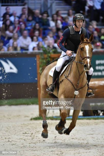 Thomas CARLILE of France riding Opium de Boisy during the Cross Indoor sponsored by Tribune de Genève Rolex Grand Slam Geneva 2017