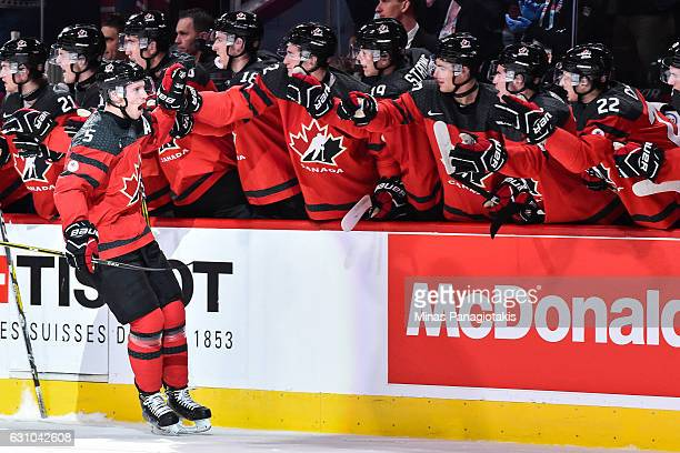 Thomas Chabot of Team Canada celebrates his first period goal with teammates on the bench during the 2017 IIHF World Junior Championship gold medal...