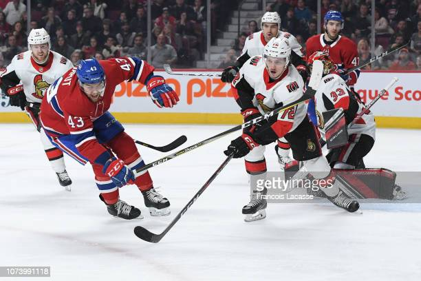 Thomas Chabot of the Ottawa Senators clears the puck while being challenged by Michael Chaput of the Montreal Canadiens in the NHL game at the Bell...