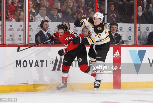 Thomas Chabot of the Ottawa Senators collides with Frank Vatrano of the Boston Bruins at Canadian Tire Centre on January 25 2018 in Ottawa Ontario...
