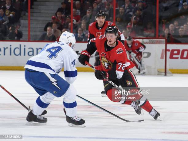 Thomas Chabot of the Ottawa Senators fires the puck past Jan Rutta of the Tampa Bay Lightning at Canadian Tire Centre on April 1 2019 in Ottawa...