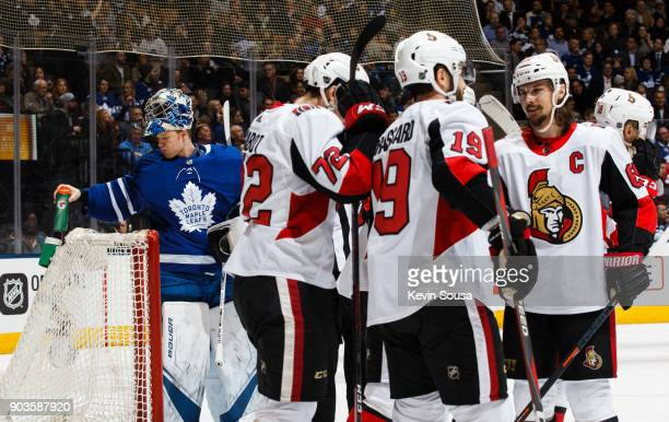 Thomas Chabot of the Ottawa Senators is congratulated after his goal on Frederik Andersen of the Toronto Maple Leafs by teammates Derick Brassard and...