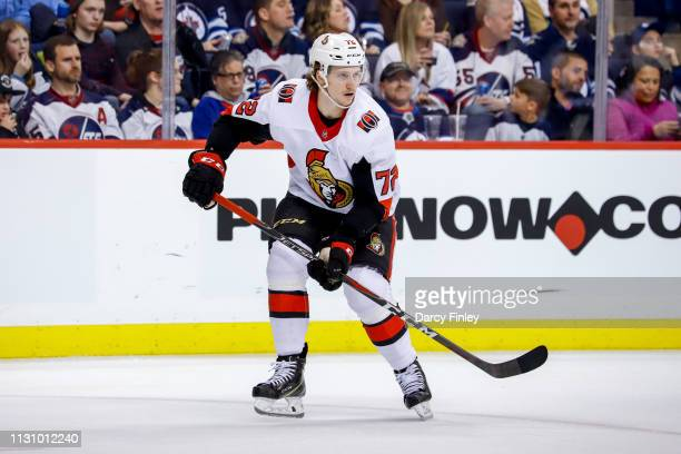 Thomas Chabot of the Ottawa Senators keeps an eye on the play during second period action against the Winnipeg Jets at the Bell MTS Place on February...