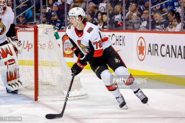Thomas Chabot of the Ottawa Senators plays the puck around the net during first period action against the Winnipeg Jets at the Bell MTS Place on...