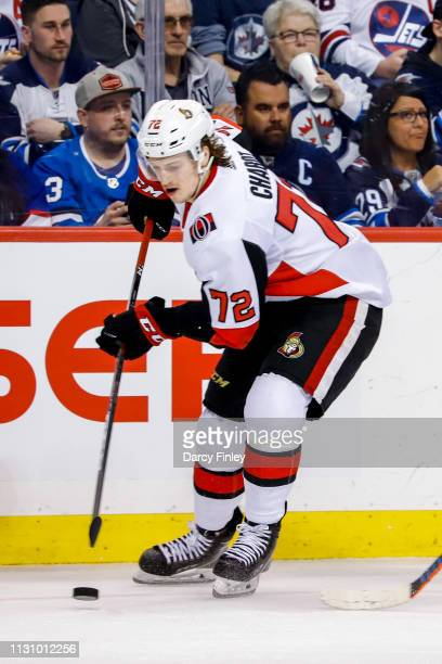 Thomas Chabot of the Ottawa Senators plays the puck down the ice during second period action against the Winnipeg Jets at the Bell MTS Place on...