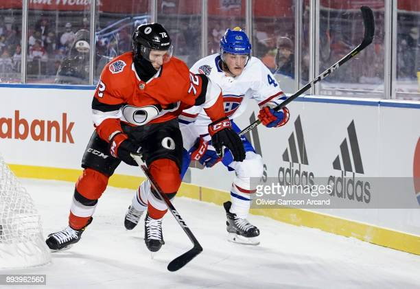 Thomas Chabot races Byron Froese to the corner for the loose puck during the 2017 Scotiabank NHL 100 Classic at Lansdowne Park on December 16 2017 in...