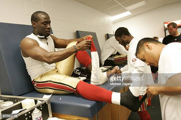 Thomas Clayton of the San Francisco 49ers is taped in the locker room before the NFL game against the Chicago Bears at Soldier Field on August 21...