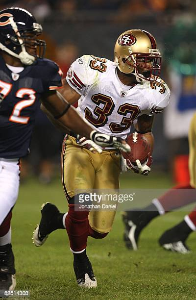 Thomas Clayton of the San Francisco 49ers runs for yardage against the Chicago Bears on August 21 2008 at Soldier Field in Chicago Illinois The 49ers...