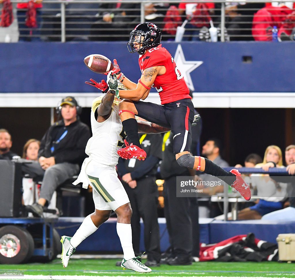 Thomas Cletcher #5 of the Baylor Bears breaks up a pass intended for Antoine Wesley #22 of the Texas Tech Red Raiders during the game on November 25, 2016 at AT&T Stadium in Arlington, Texas. Texas Tech defeated Baylor 54-35.