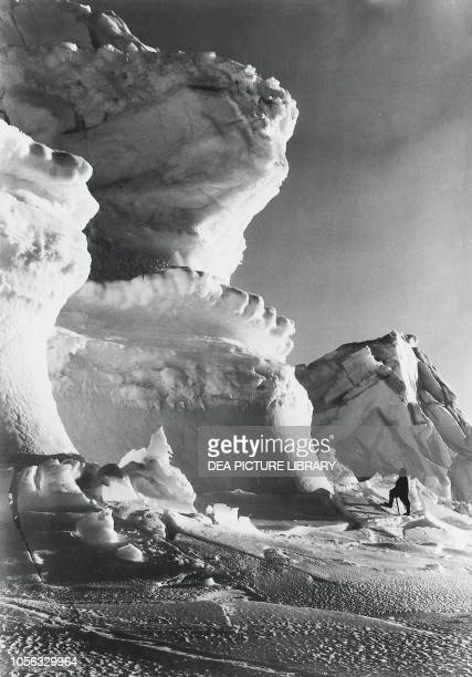 Thomas Clissold and the huge ice bastions of the Castle Berg, September 17 photo by Herbert Ponting, Robert Falcon Scott's Terra Nova expedition to...