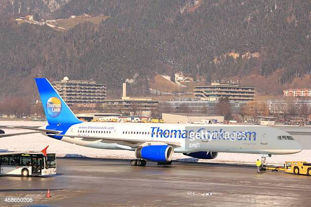 thomas cook boeing 757-200 passenger jet in innsbruck - pejft stock pictures, royalty-free photos & images