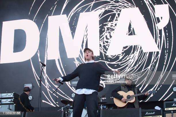 Thomas Crandles Thomas O'Dell Johnny Took of the DMA's performing on stage during Isle of Wight Festival 2019 at Seaclose Park on June 14 2019 in...