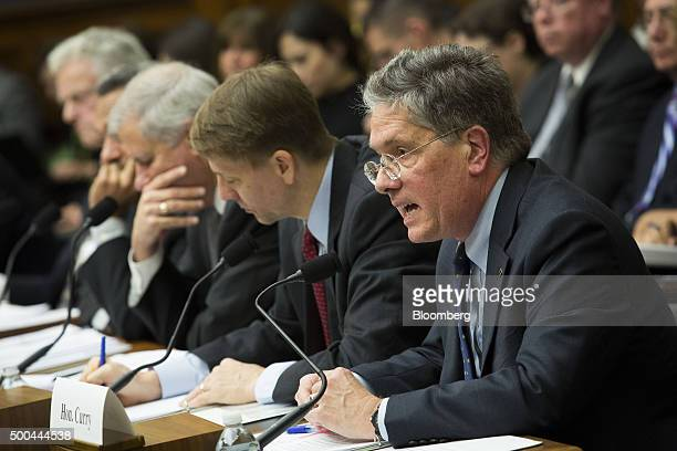 Thomas Curry comptroller of the US currency right testifies during a House Financial Services Committee hearing with Richard Cordray director of the...