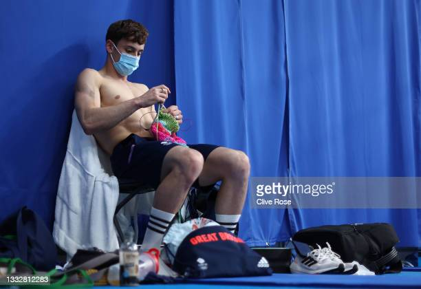 Thomas Daley of Team Great Britain is seen knitting before the Men's 10m Platform Final on day fifteen of the Tokyo 2020 Olympic Games at Tokyo...