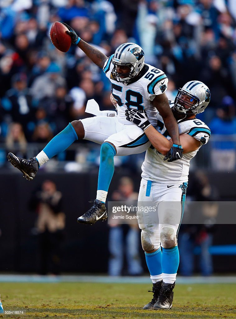 Thomas Davis #58 and teammate Ryan Kalil #67 of the Carolina Panthers celebrate an onside kick recovery against the Seattle Seahawks in the 4th quarter during the NFC Divisional Playoff Game at Bank of America Stadium on January 17, 2016 in Charlotte, North Carolina.